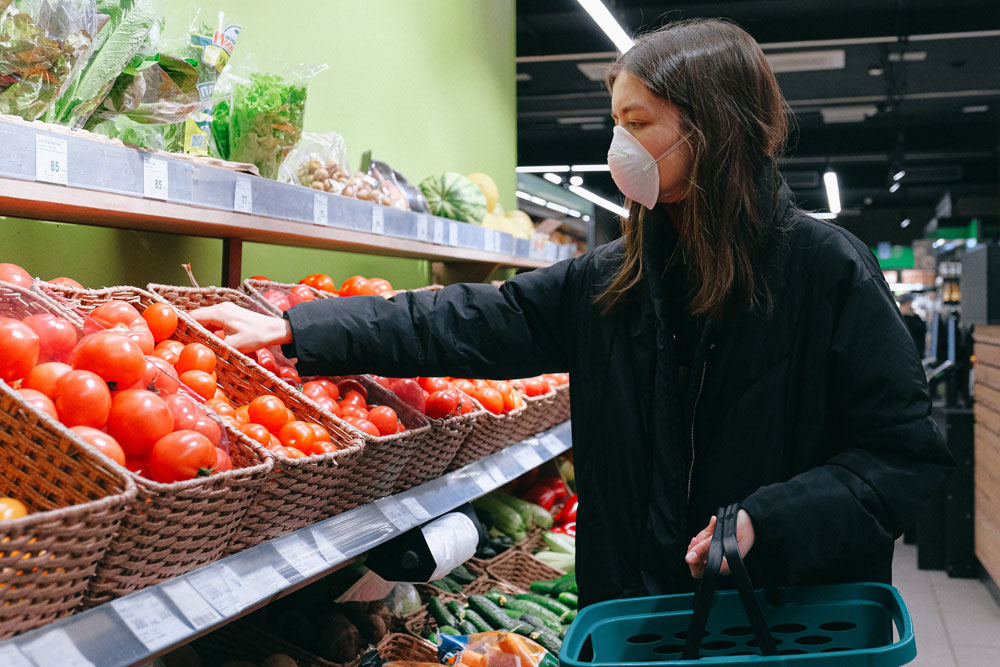 woman-in-face-mask-shopping-in-supermarket-3987217