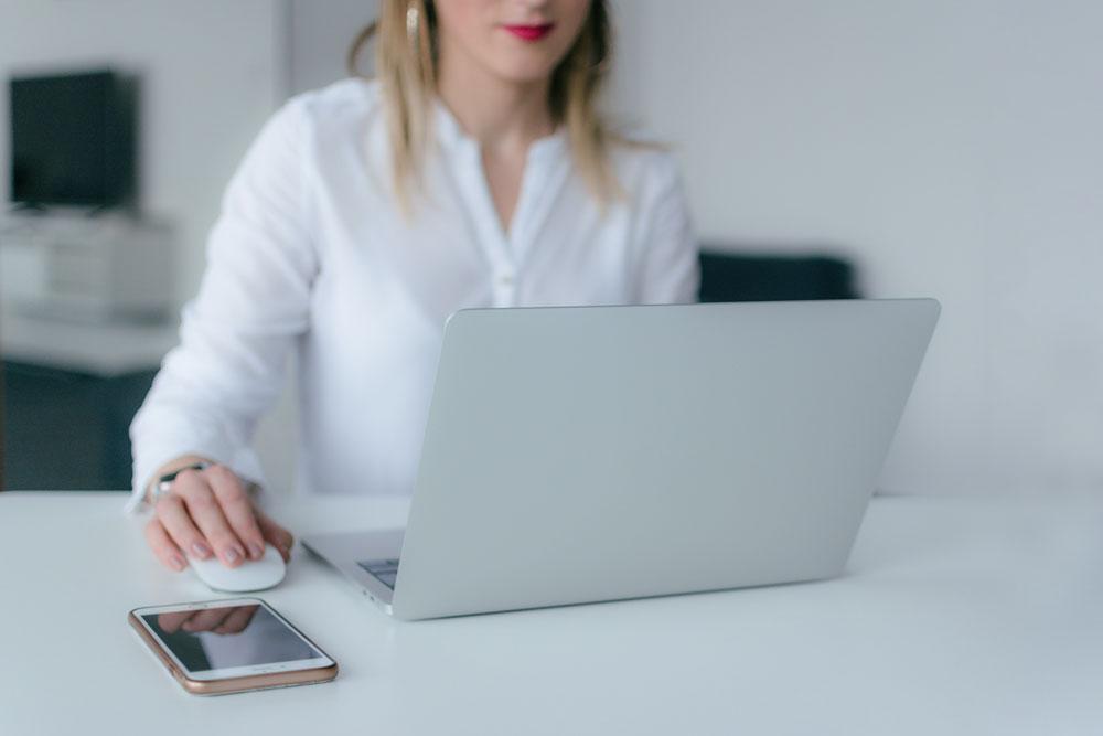 woman-using-silver-laptop-2265488