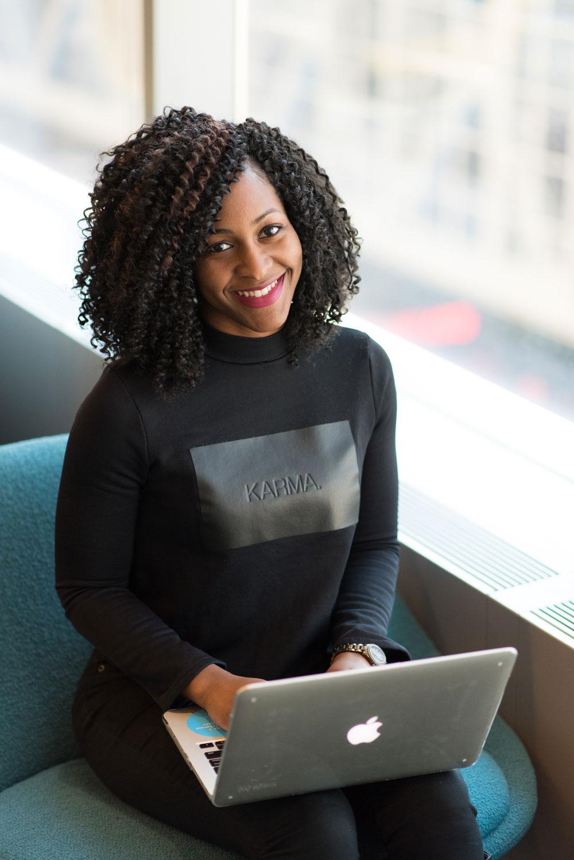 woman-wearing-black-sweatshirt-using-silver-macbook-1181230