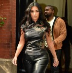 Kim Kardashian steps out of her hotel in Asian inspired top in NY