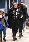 Madonna and boyfriend Ahlamalik Williams arrive at JFK Airport with the kids