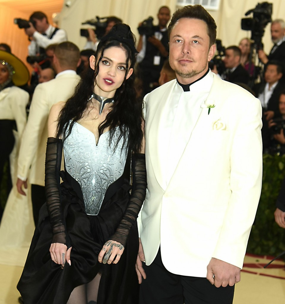 Grimes and Elon Musk at the Costume Institute Benefit at the Metropolitin Museum of Art at the opening of 'Heavenly Bodies: Fashion and the Catholic Imagination' in New York City