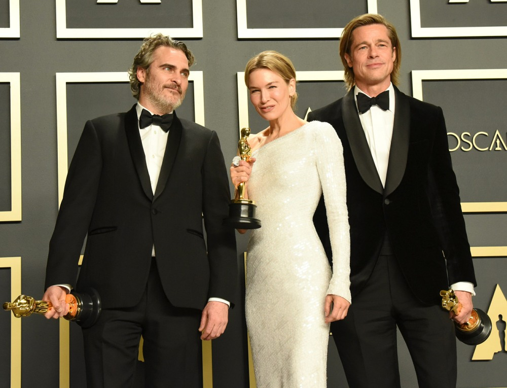 Joaquin Phoenix, Renee Zellweger, Brad Pitt in the press room during the 92nd Annual Academy Awards...