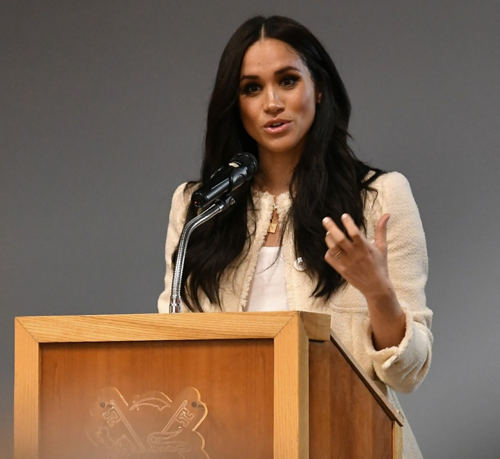 Britain's Meghan, Duchess of Sussex speaks during a school assembly as part of a visit to Robert Clack School in Essex, on March 6, 2020, in support of International Women's Day.  / == STRICTLY EMBARGOED == NO USE AND NO PUBICATION ON ANY PLATFORM UNTIL