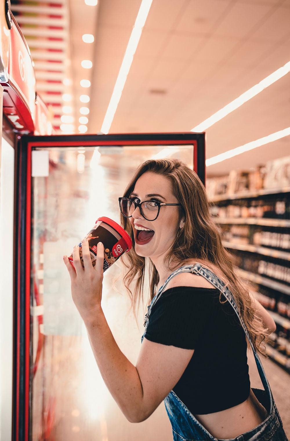 woman-holding-ice-cream-tub-2295192