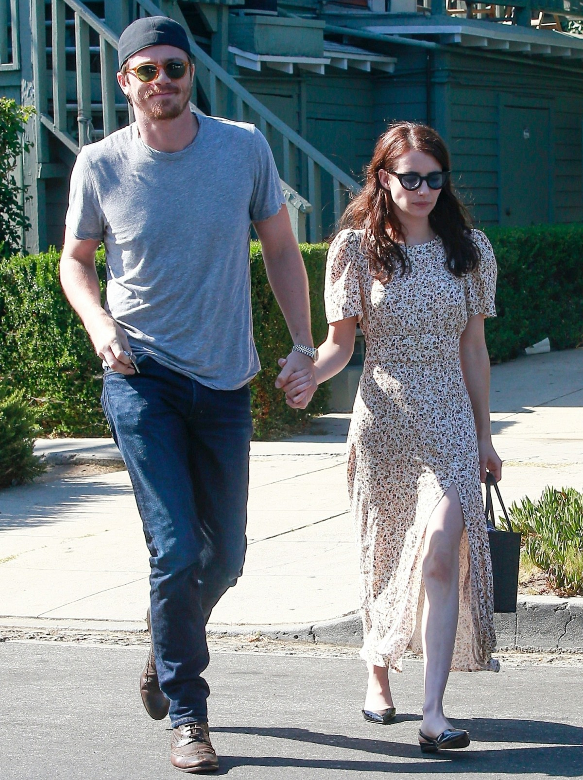 Emma Roberts and Garrett Hedlund hold hands as they head to the movies