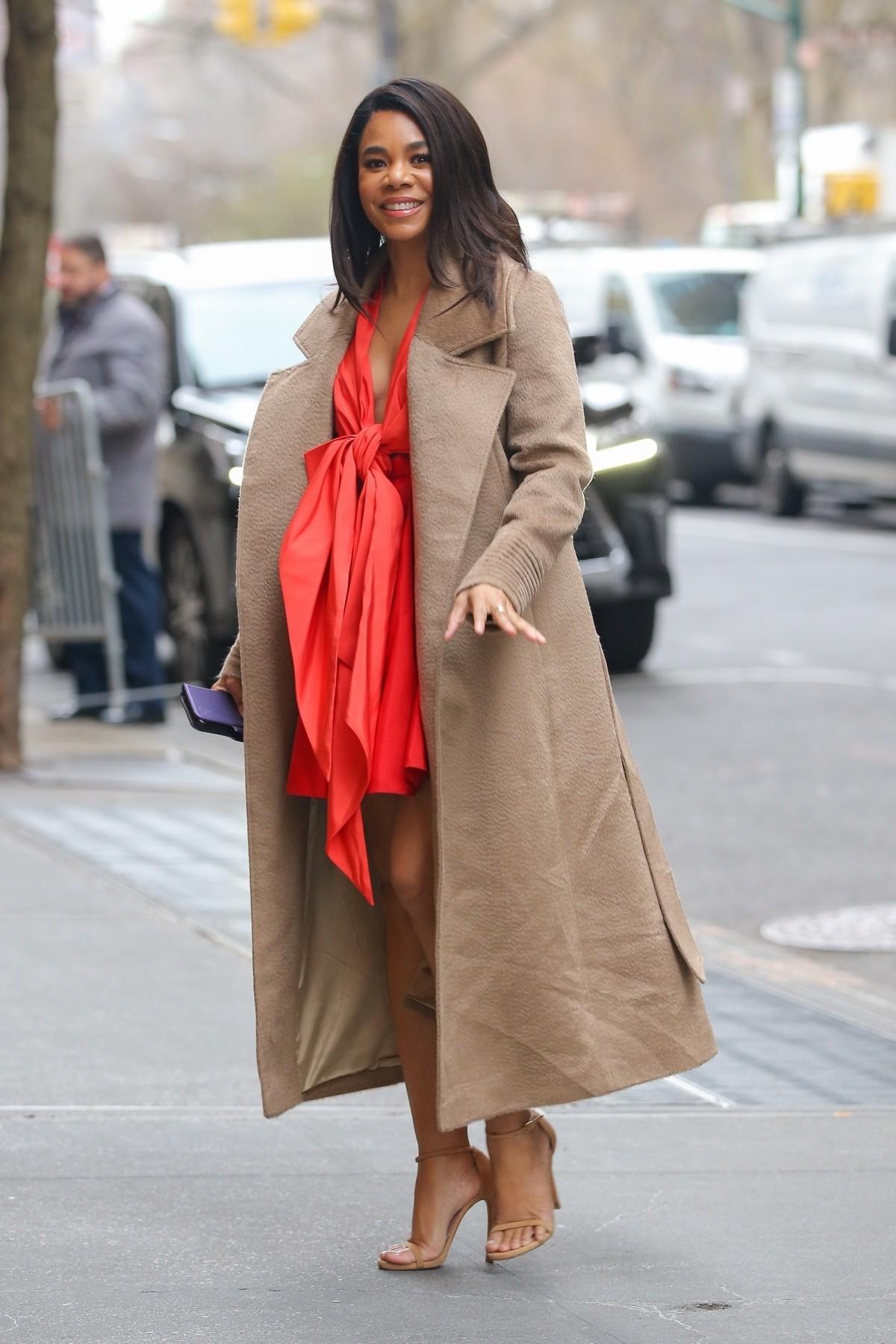 Regina Hall looks stunning in an orange mini dress with a big bowtie