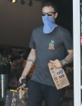 Brian Austin Green waits in line to go grocery shopping in Calabasas