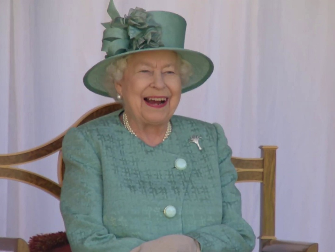 The Queen seen laughing while enjoying a celebration to mark her official birthday