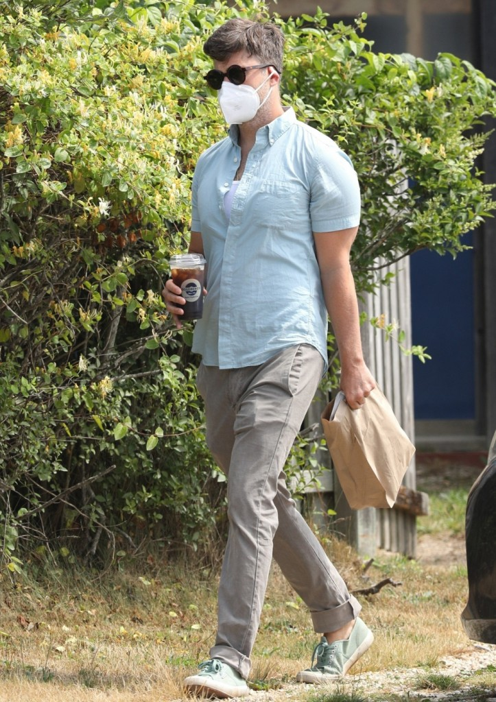 Scarlett Johansson's fiancee and SNL host, Colin Jost grabs coffee to go in The Hamptons