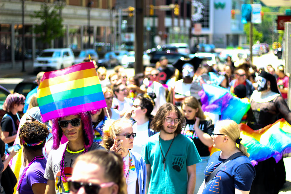 crowd-walking-at-the-sidewalk-2306784