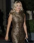 Kate Moss wears a flattering leopard print halter neck dress as she arrives with boyfriend Nikolai von Bismarck at The Hotel De Crillon in Pari
