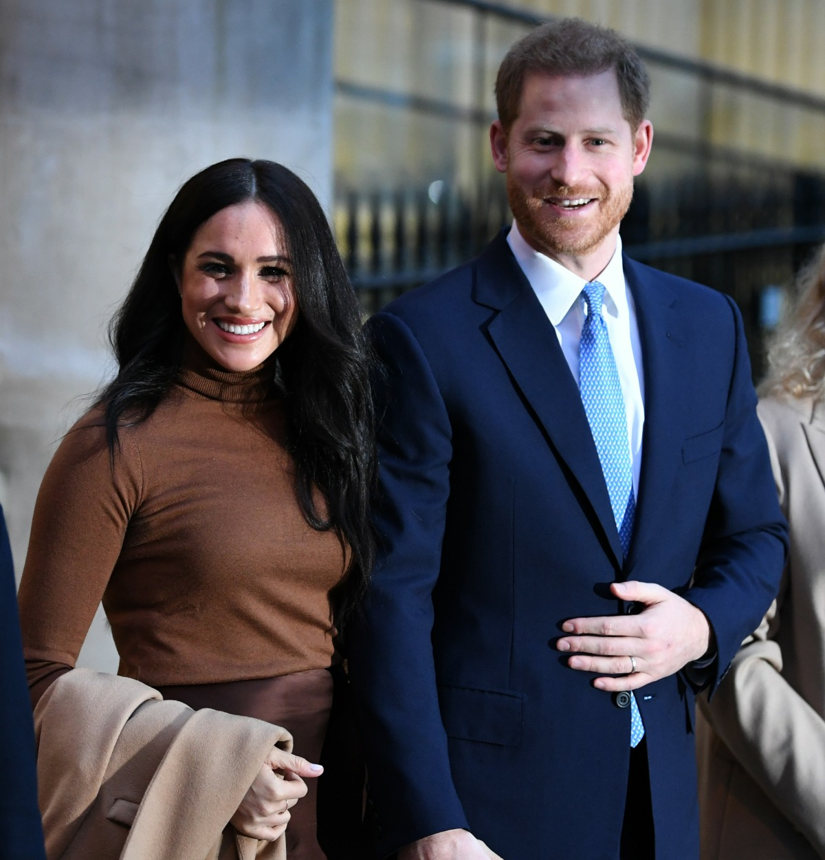 Britain's Prince Harry, Duke of Sussex (2R) and Meghan, Duchess of Sussex (2L) stand with the High Commissioner for Canada in the United Kingdom, Janice Charette (R) and the deputy High Commissioner, Sarah Fountain Smith (L), as they leave after their visi