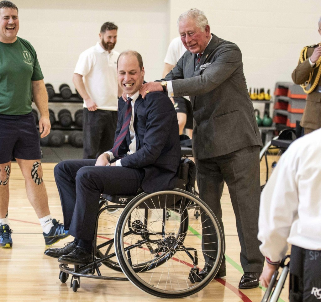 The Duke of Cambridge has his shoulders rubbed by Prince Charles after the duke attempted and failed...