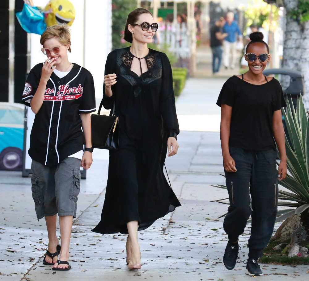 Angelina Jolie takes the girls for some retail therapy at Kitson