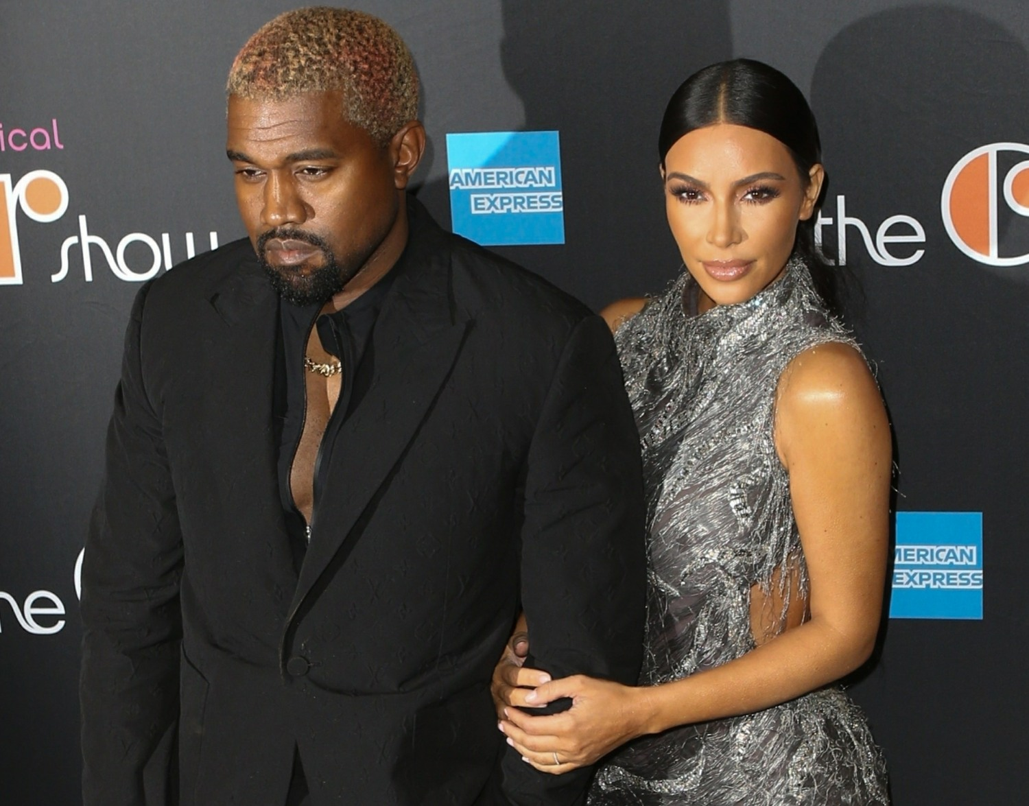 Kim Kardashian and Kanye West arrive on the black carpet at the Cher musical