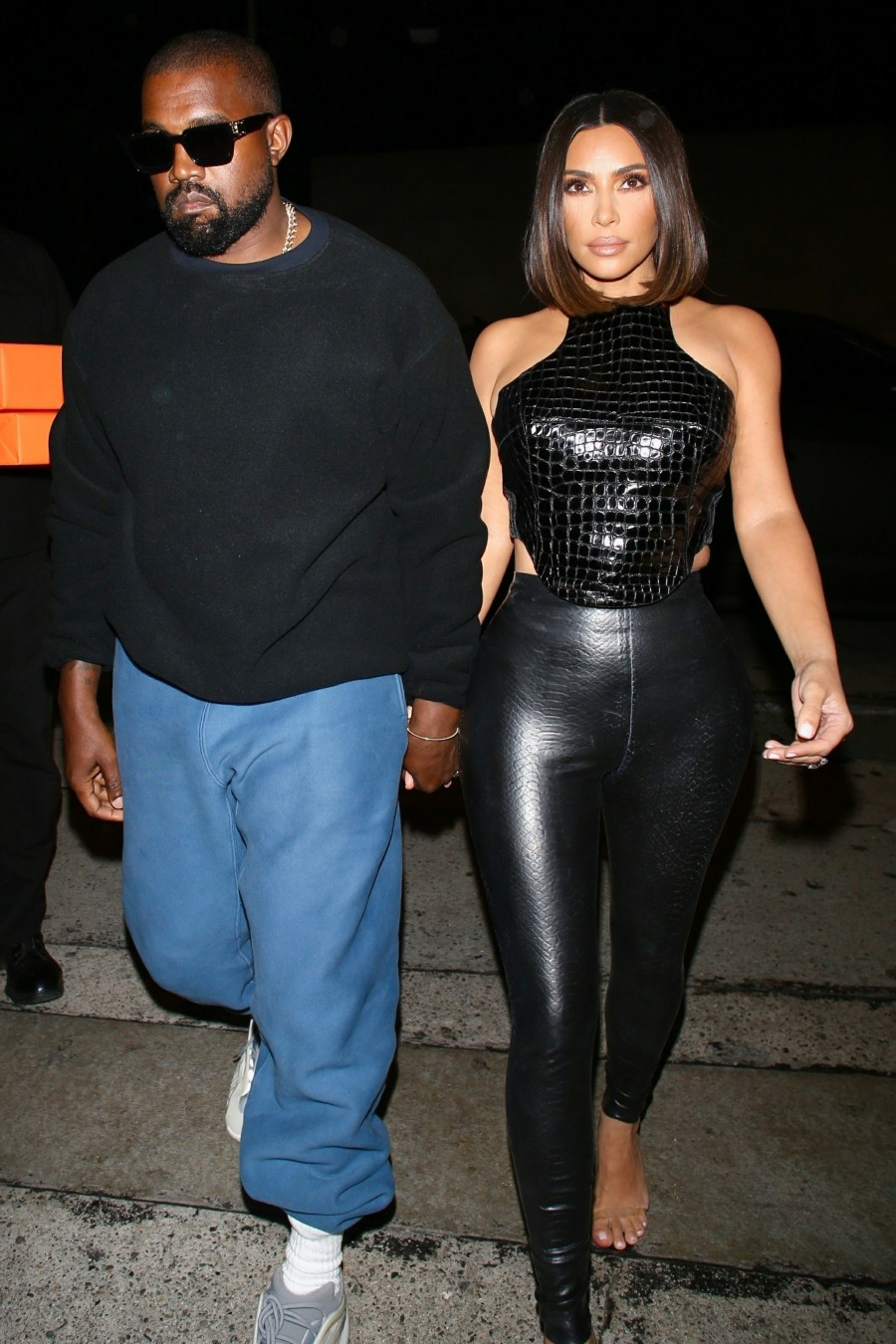 Kanye West and wife Kim Kardashian arrive for a dinner party at Craig's
