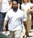 Kanye West exiting his office after a few morning meetings