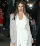 Lea Michele beams in a white dress while posing for our cameras in NYC