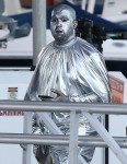Kanye West attends a church event in Miami covered in silver