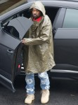 Kanye West heads to the Office on a Rainy Day