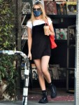 Emma Roberts shops for magazies at a newsstand