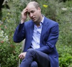 Britain's Prince William speaks with service users during a visit to the Garden House part of the Light Project in Peterborough, England, Thursday, July 16, 2020. The Garden House offers information, advice and support to the rough sleepers in Peterborough.