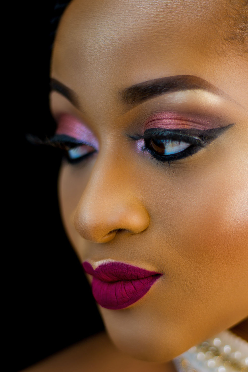 close-up-photo-of-beautiful-woman-in-make-up-looking-away-2301280