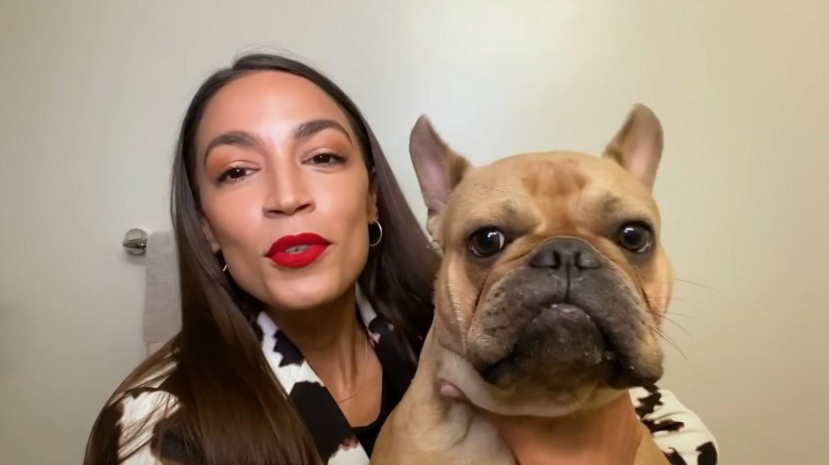 Alexandria Ocasio-Cortez  with her dog, Deco