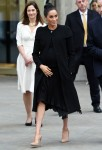 Pregnant Meghan Markle greets members of the public while leaving the Association of Commonwealth Universities in London
