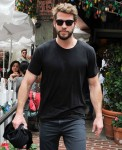 Liam Hemsworth and new girlfriend Gabriella Brooks leave The Ivy after lunch with friends