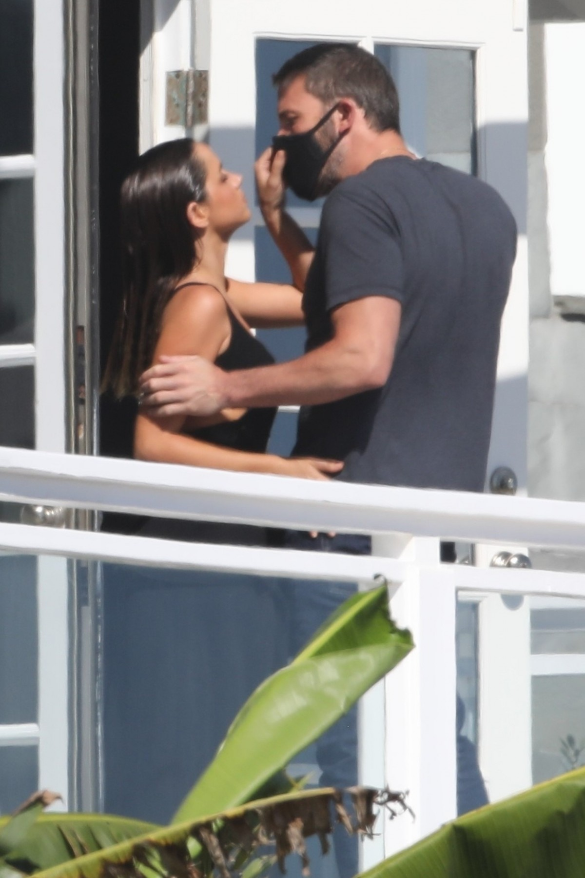 Ben Affleck's girlfriend Ana de Armas pulls down his mask for a kiss at a beach photoshoot
