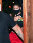 Kylie Jenner attempts to lay low covering her face while leaving 40 Love with a friend!