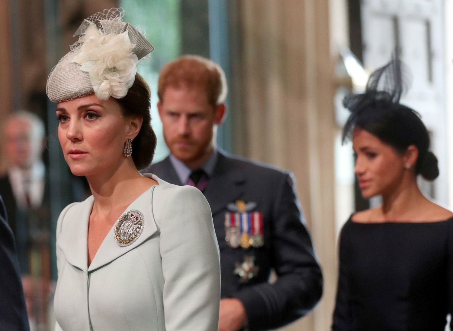 Britain's Prince Harry, his wife Meghan, the Duke and Duchess of Sussex, and Catherine, Duchess of Cambridge arrive at Westminster Abbey for a service to mark the centenary of the Royal Air Force