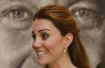Kate, Duchess of Cambridge, arrives to attend an evening reception at National Portrait Gallery