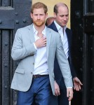 Prince Harry greets the crowds outside Windsor Castle on the evening before his wedding to Meghan Markle
