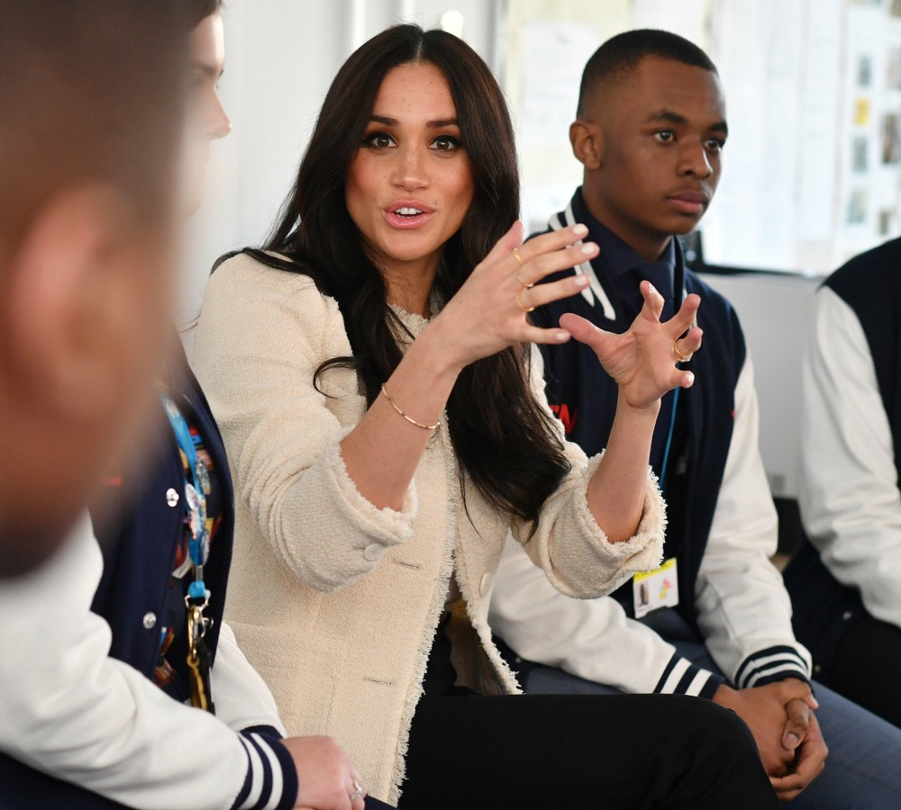 Britain's Meghan, Duchess of Sussex, sits in a discussion of the 'Senior Debate Squad' during a visit to Robert Clack School in Essex, on March 6, 2020, in support of International Women's Day.  / == STRICTLY EMBARGOED == NO USE AND NO PUBICATION ON ANY