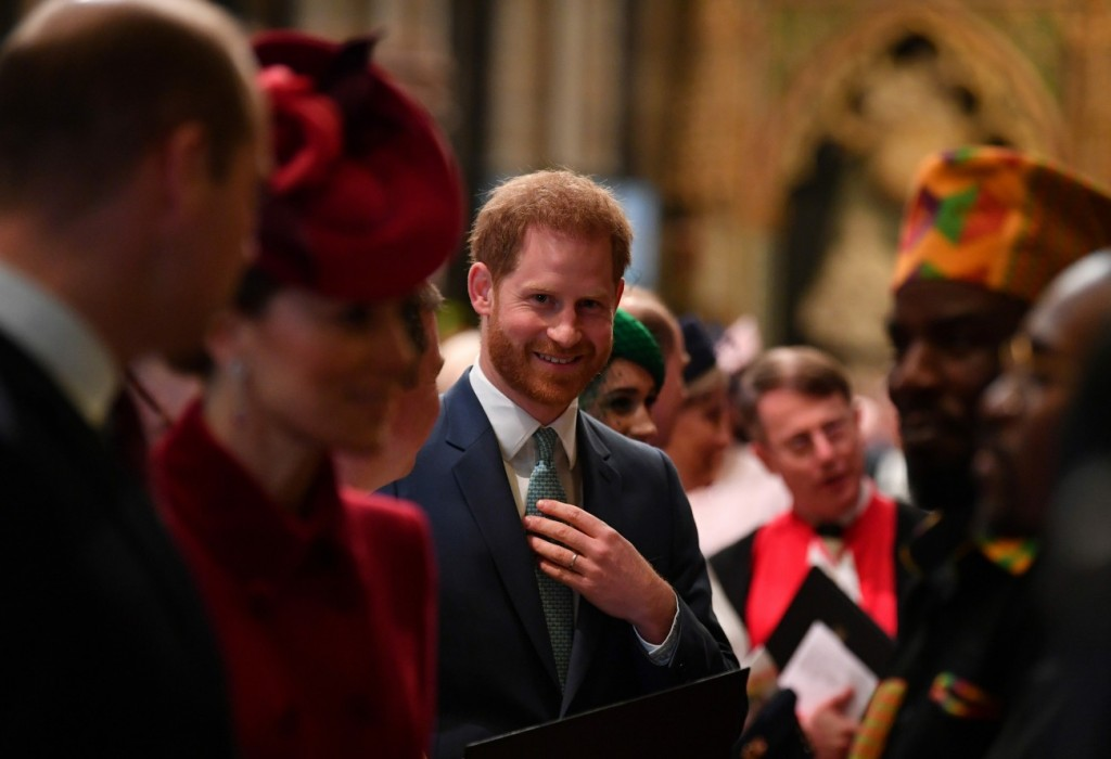 Britain's Prince Harry, Duke of Sussex (C) is introduced to performers as he leaves after attending  the annual Commonwealth Service at Westminster Abbey in London on March 09, 2020. - Britain's Queen Elizabeth II has been the Head of the Commonwealth thro