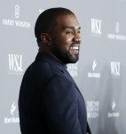 Kim Kardashian and hubby Kanye West pose for a photo at the WSJ Innovator Awards in NYC
