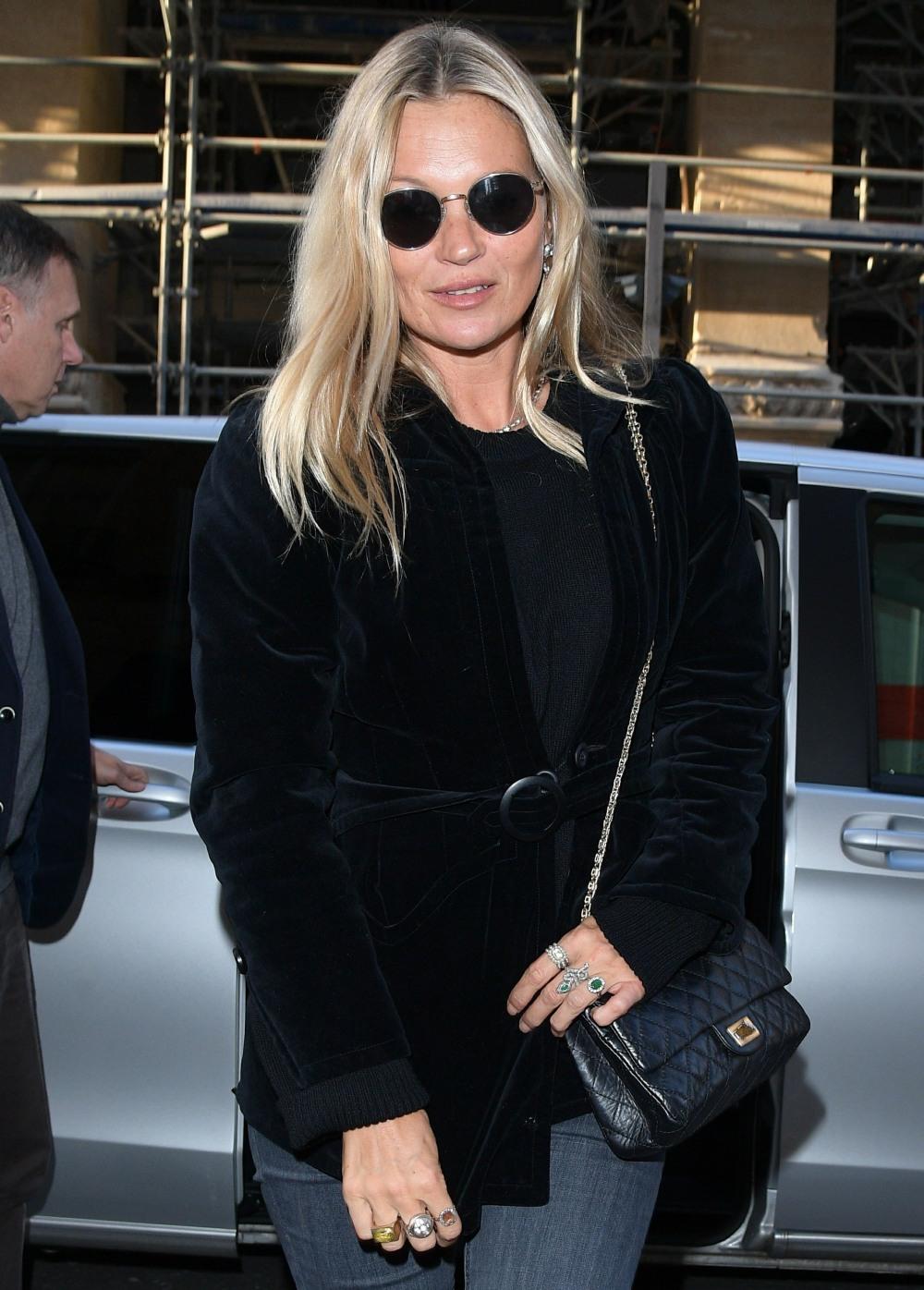 Kate Moss strolls through the Marais district during Paris Fashion Week in Paris