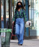 Katie Holmes carries a bouquet of flowers and shops at the supermarket in NYC