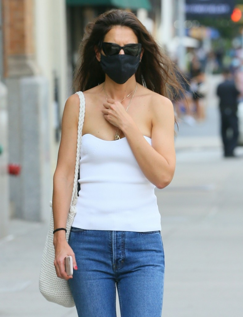 Katie Holmes beats the heat in a strapless top while handling some errands in SoHo