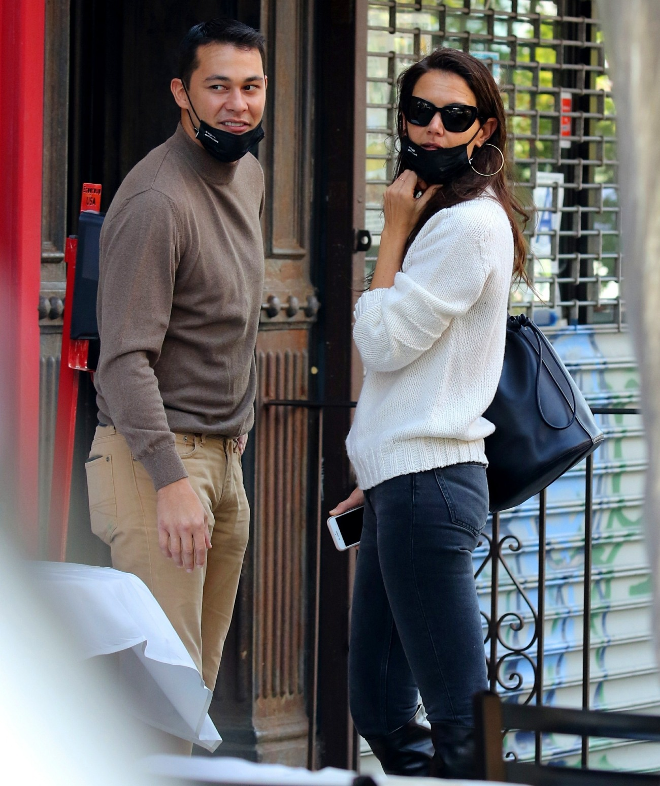 Katie Holmes and Emilio Vitolo are all smiles as they continue another steamy make-out session outside his restaurant in NYC