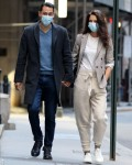 Katie Holmes and boyfriend Emilio Vitolo walk hand-in-hand as they go for a joyride in his red Pontiac