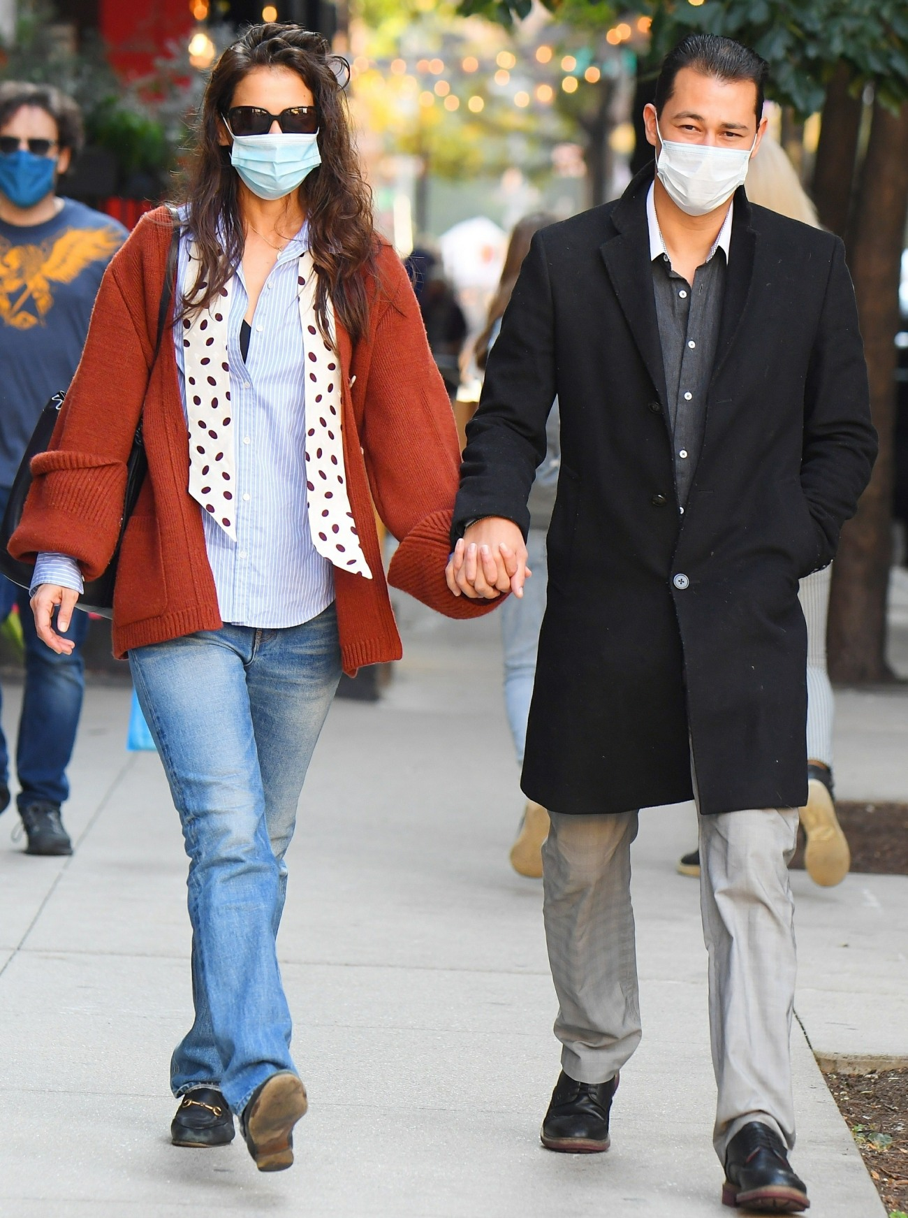 Katie Holmes and Emilio Vitolo Jr hold hands as they stroll in SoHo