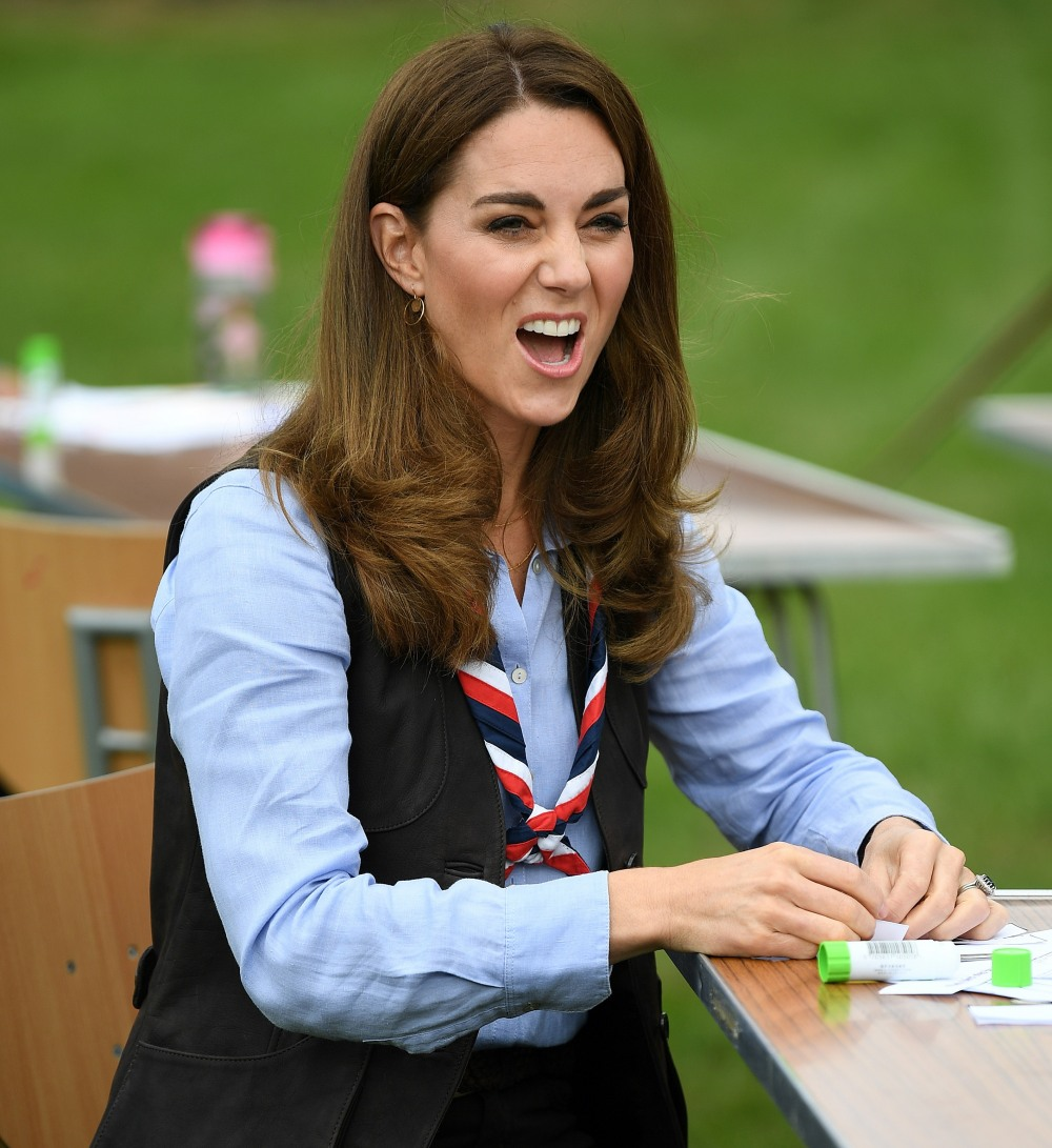 Britain's Catherine, Duchess of Cambridge talks with members of the Beavers as she visits a Scout Group in Northolt, northwest London on September 29, 2020, where she joined Cub and Beaver Scouts in outdoor activities. - The Duchess learned how the Scouts have adapted during the COVID-19 pandemic, and continued Scouting sessions and online activities.