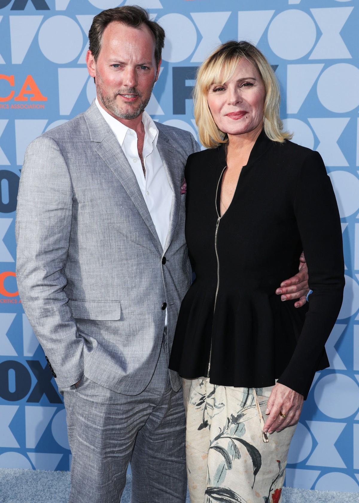 Russell Thomas and actress Kim Cattrall arrive at the FOX Summer TCA 2019 All-Star Party held at Fox Studios on August 7, 2019 in Los Angeles, California, United States.