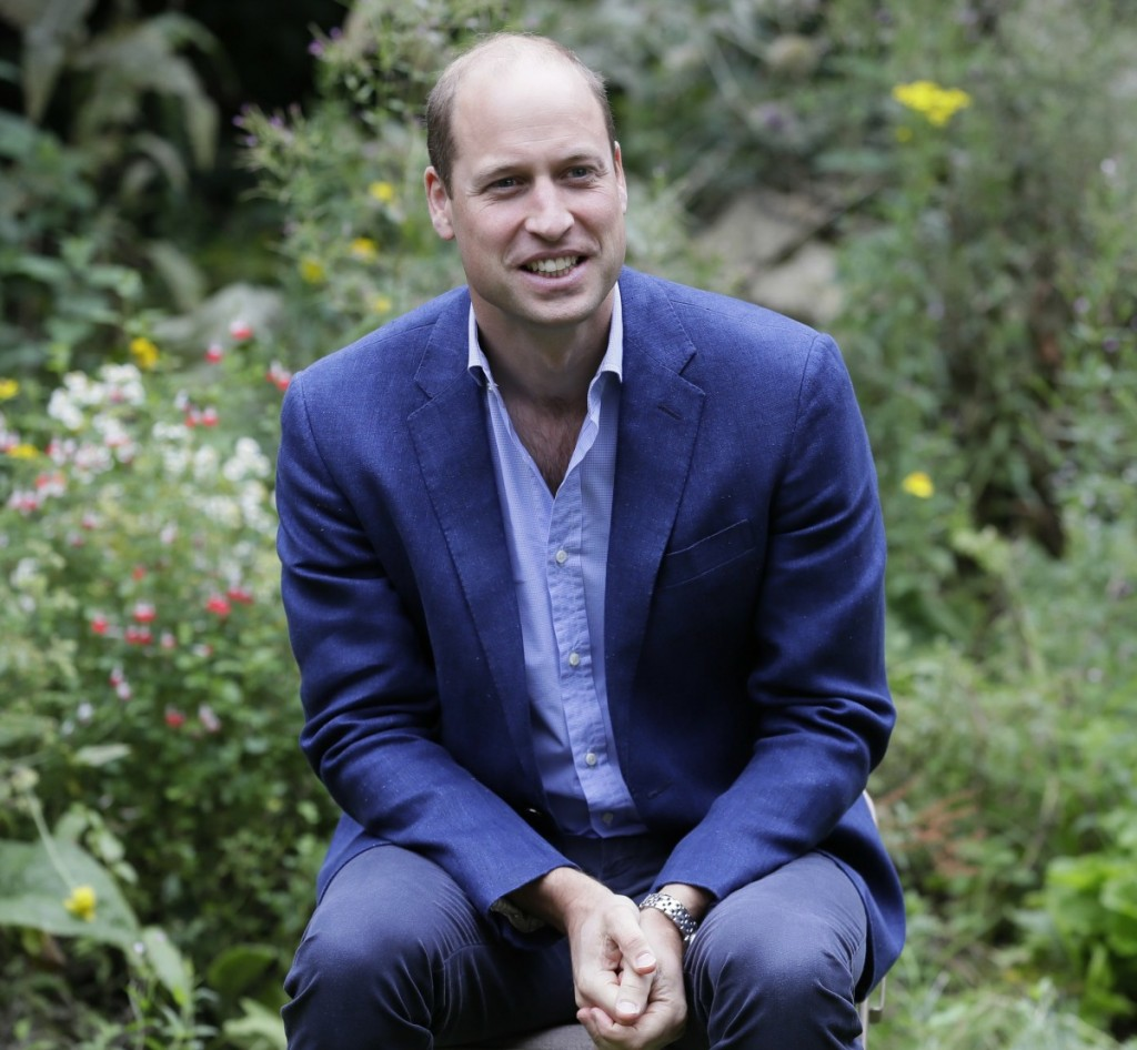 Britain's Prince William speaks with service users during a visit to the Garden House part of the Light Project in Peterborough, England, Thursday, July 16, 2020. The Garden House offers information, advice and support to the rough sleepers in Peterborough