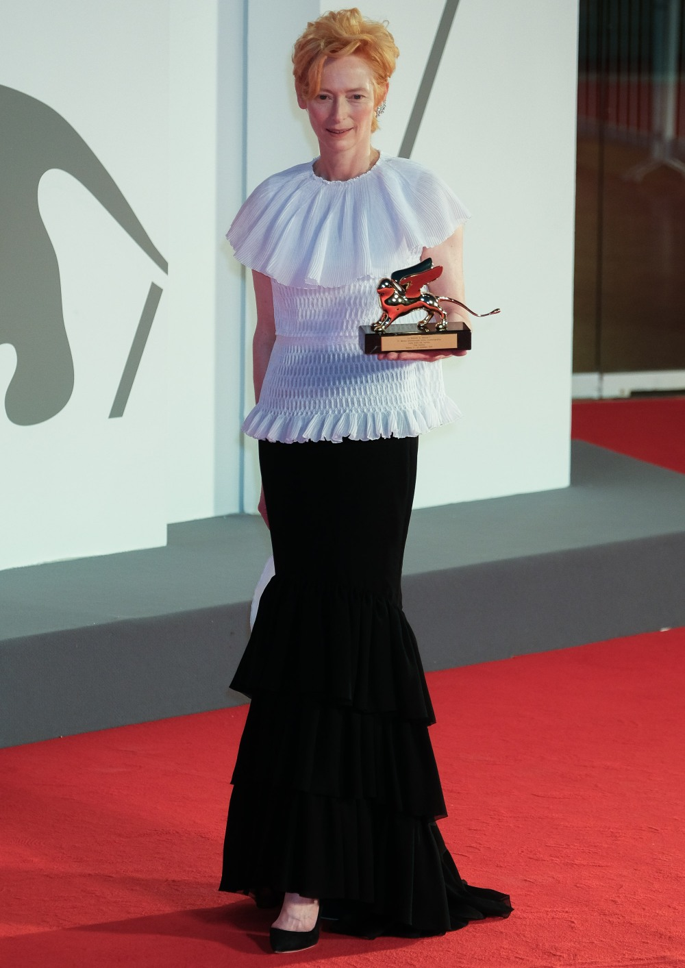 Tilda Swinton poses on the red carpet at Opening Ceremony for the 77th Venice International Film Festival ( Berlinale ) on Wednesday 2 September 2020