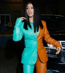 Cardi B turns heads in two-tone pantsuit leaving the Vogue Forces of Fashion Summit